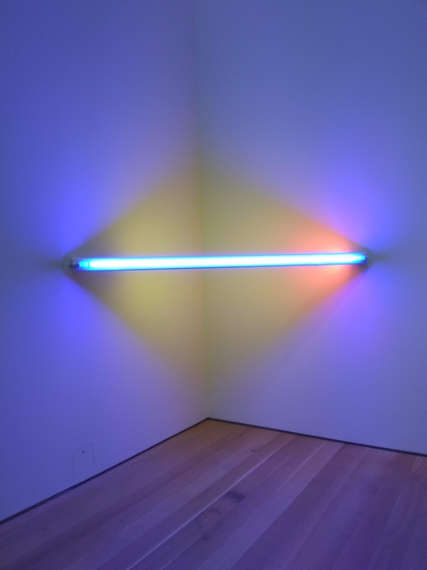 light sculpture with blue and yellow lights in a triangle configuration